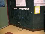 Audio/video/communications cables handing over hole to control room.